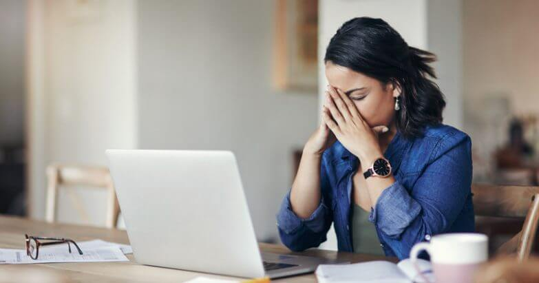 Young woman looking stressed and trying to deal with bad tenants.